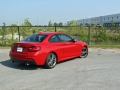 2015-BMW-M235i-xDrive-Review-rear-side-angle