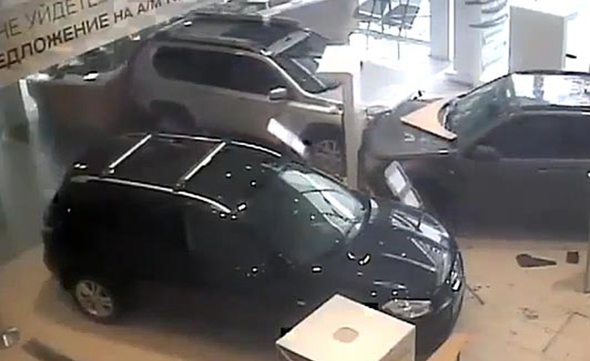 Man Goes Wild In Russian Nissan Dealership – Video
