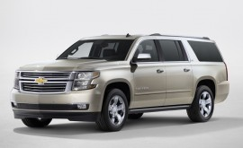 2015 Chevrolet Suburban in Champagne side view from New York rev