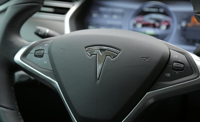 Tesla Motors Reports $74 Million Net Loss in 2013