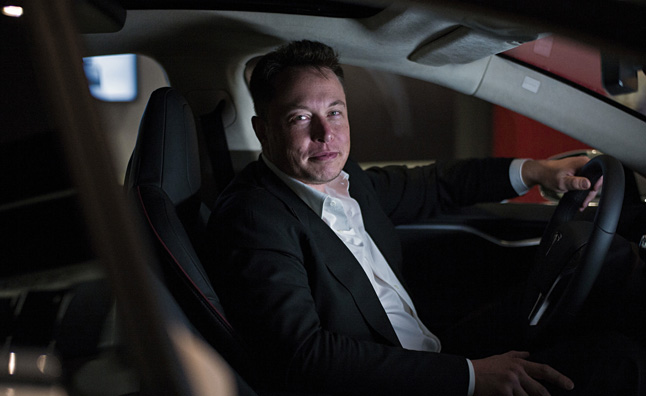 Elon Musk in a Tesla car.