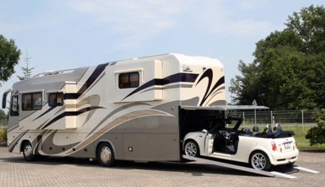 New vario motorhome features built in a garage for your for Class a rv with car garage
