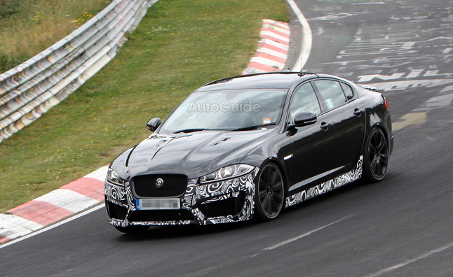 spy photos of the upcoming Jaguar XFR-S suggest, showing the car in