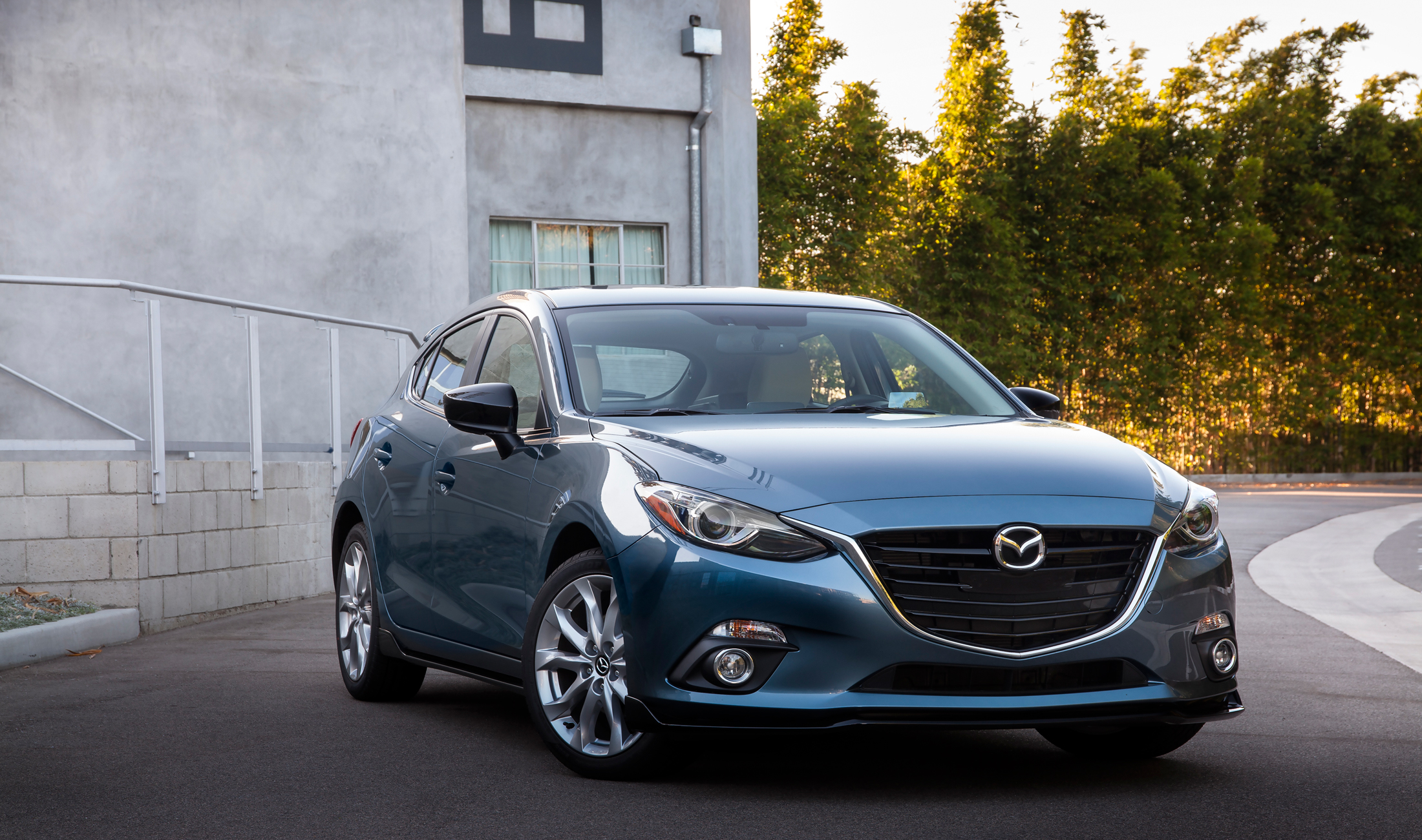 zoom door touring grand mazda review the hatchback objective mane s zoomzoom