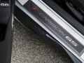 Exclusive Carbon 65 sill plates greet driver and passenger.