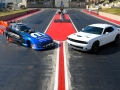 On June 19, 2018 in Denver, the drag-oriented, street-legal 2019 Dodge Challenger R/T Scat Pack 1320 (right) was unveiled next to the new 2019 Mopar Dodge Charger SRT Hellcat NHRA Funny Car body (left) prior to the Dodge Mile-High NHRA Nationals Powered by Mopar at Bandimere Speedway.