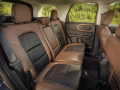 The available Badlands Package on Bronco Sport includes 60/40 split fold-flat second-row leather two-tone seats with a flip-down center armrest and cupholders. (Pre-production model pictured.)