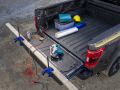 All-new F-150 with available Pro Power Onboard, standard clamp pockets so customers can hold materials down for precision work, standard cleats mounted to the sides of the tailgate to act as tie-down locations for extra-long items in the bed and available Tailgate Work Surface including integrated rulers, a mobile device holder, cupholder and pencil holder.