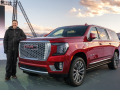 Vice President Global Buick and GMC Duncan Aldred with the next-generation 2021 GMC Yukon XL Denali at its unveiling Tuesday, January 14, 2019 at an outdoor event near Vail, Colorado. The Yukon XL retains its crown as GMC's roomiest SUV for both passengers and cargo, benefitting from a 4.1-inch increase in wheelbase. The result is an increase in both passenger and cargo space, with only a fractional change (less than 1%) to Yukon XL's overall length. (Photo by Steve Fecht for GMC)