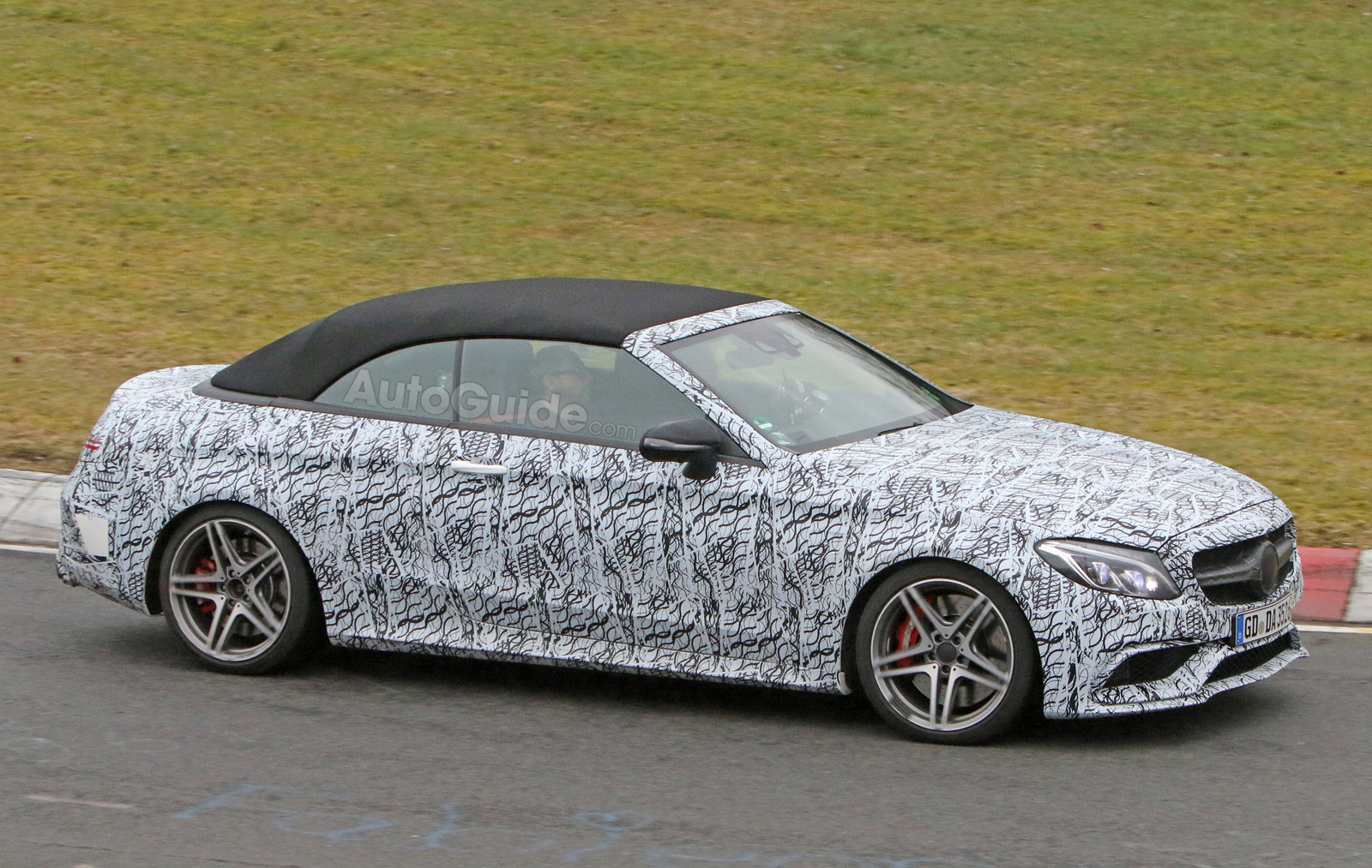 http://www.autoguide.com/blog/wp-content/gallery/mercedes-amg-c63-convertible-spy-photos-march-21-2016/mercedes-amg-c63-convertible-spy-photos-05.jpg