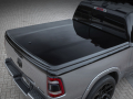 "A one-piece Mopar hard tonneau cover in body color Gloss Black is featured on the Ram 1500 Big Horn ""Low Down"" Concept."