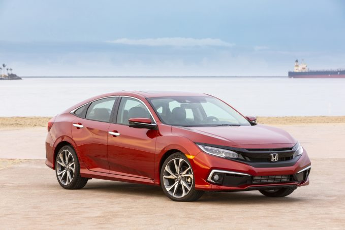 2020 Honda Civic Sedan Touring in red on the beach