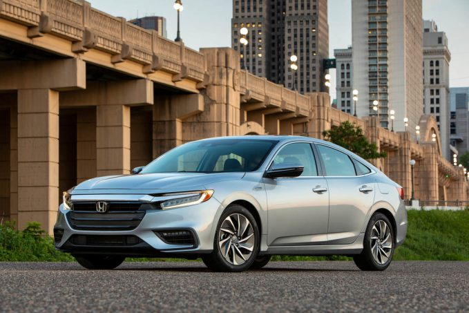 2020 Honda Insight in silver in front of bridge