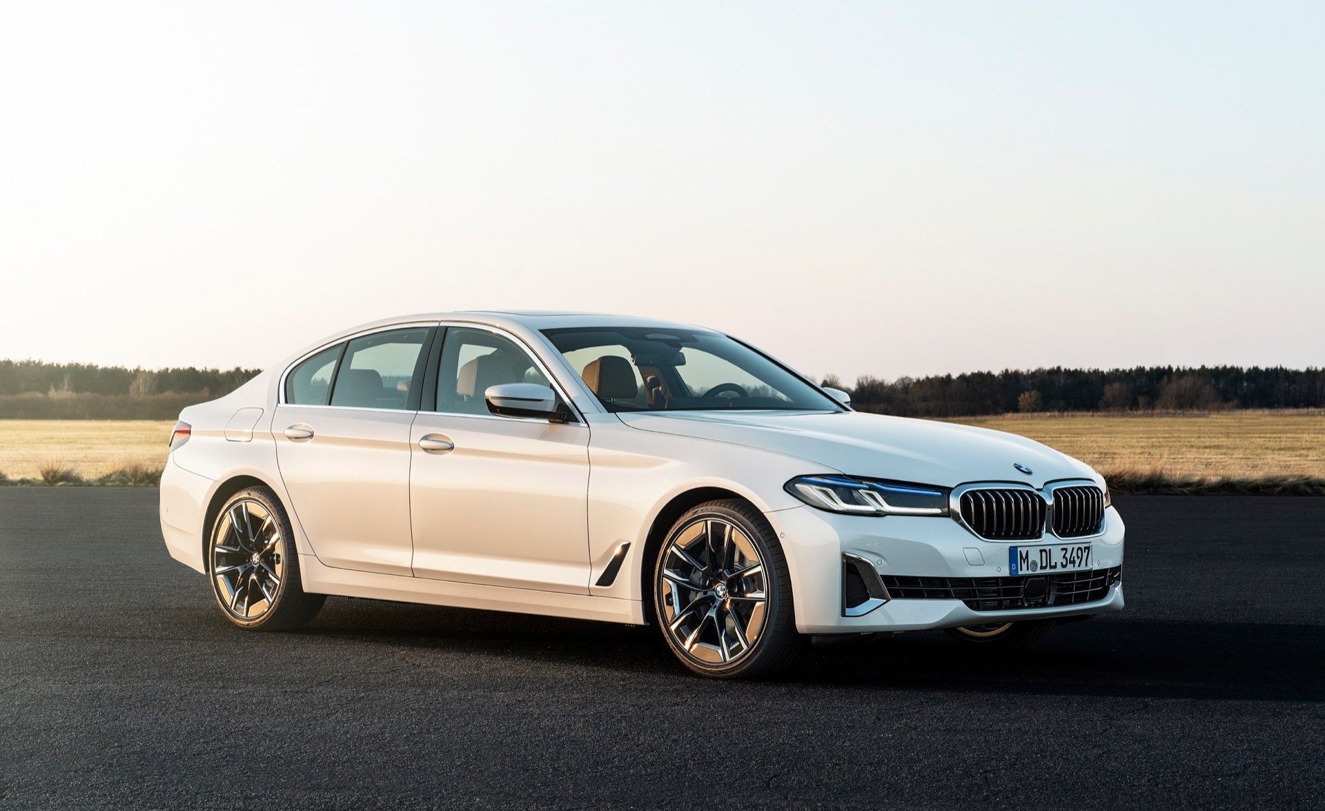 2021 BMW 540i in white front three-quarter dynamic