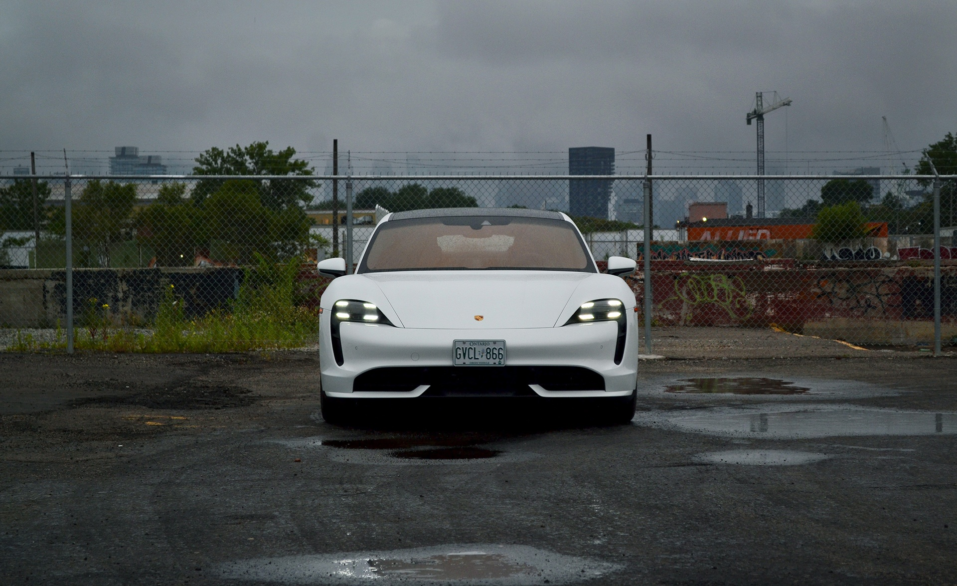 2020 Porsche Taycan Turbo in white front head-on static shot in rainy weather