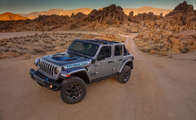 2021 Jeep Wrangler 4xe static wide angle front three-quarter in the desert