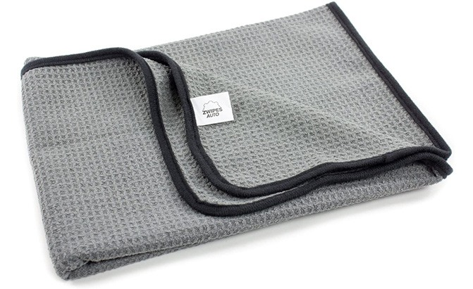The Zwipes Auto 879 Professional Microfiber Drying Towel features a medium size, deep waffle pockets, and soft finished edges with rounded corners, making them one of the best car towels.