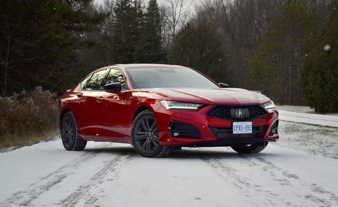 2021 Acura TLX A-Spec in red front three-quarter static shot in the snow