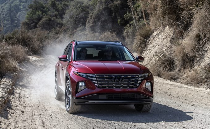2022 Hyundai Tucson in red dynamic dirt road shot