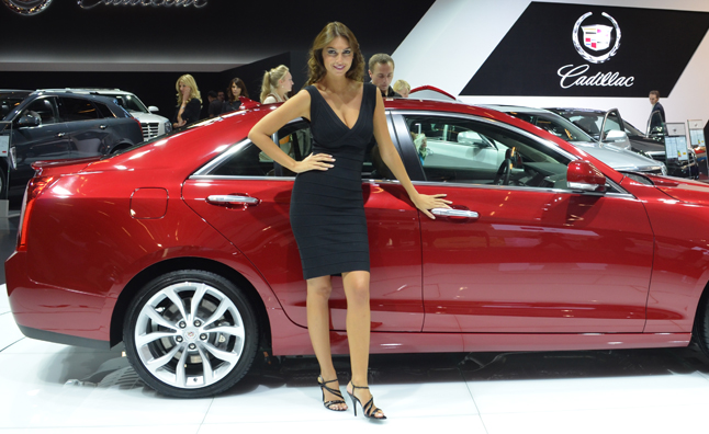 Gorgeous Models Surrounding New Cars Are Par For The Course At Auto Shows Because Even Most Boring Car Can Be Spruced Up By An Hourgl Figure And A