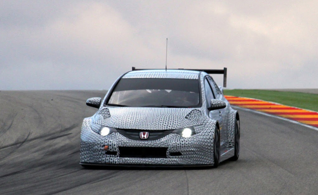 Honda Has Released The First Official Photos Of Its 2014 Civic WTCC Race Car  And Although Itu0027s Covered With Plenty Of Camouflage, The Civic Is Looking  Nice ...
