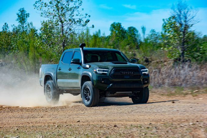 2020 Toyota Tacoma TRD Pro Army Green front quarter at speed