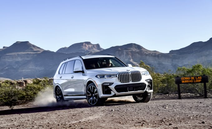2019 BMW X7 M50i in white driving on dirt