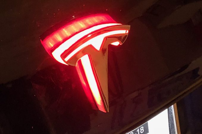 """Kits are available for both the front and rear """"T"""" emblems, with multiple finishes -- there's even one to add back-lighting to the decklid """"Tesla"""" script applique on the Model S and Model X."""