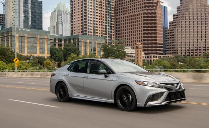 2021 Toyota Camry XSE Hybrid in silver and black