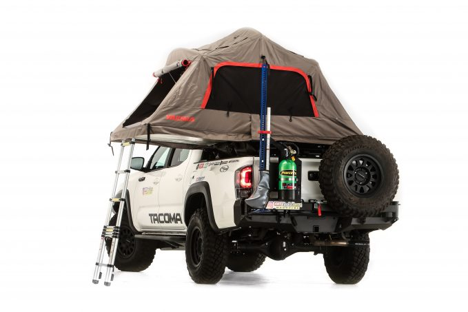 This overland-ready build features an air compressor, a four-gallon spare fuel jug and two-gallon water container, a Hi-Lift jack, and a Yakima SkyRise cargo bed tent.